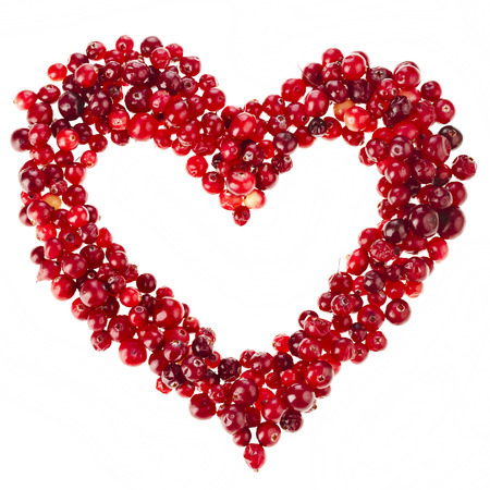 frame of red cranberries heart surface top view isolated on white background photo