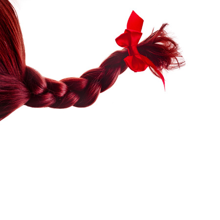 hair bow: natural hair braided with red ribbon bow isolated on white