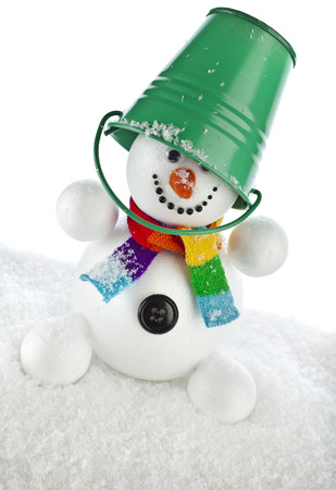 funny snowman with green color bucket on his head isolated on white background photo
