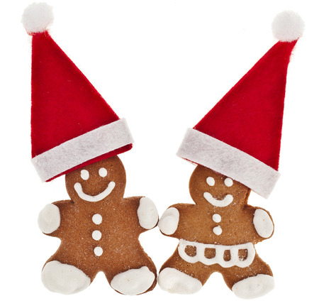 Gingerbread couple in santa hat solated on the white background photo