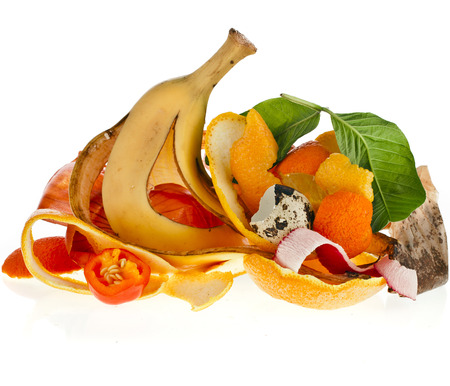organic waste: compost pile of kitchen scraps isolated on white background close up