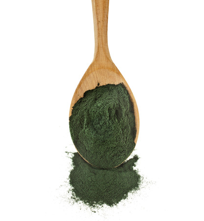 organic spirulina algae powder in wooden spoon isolated on white background