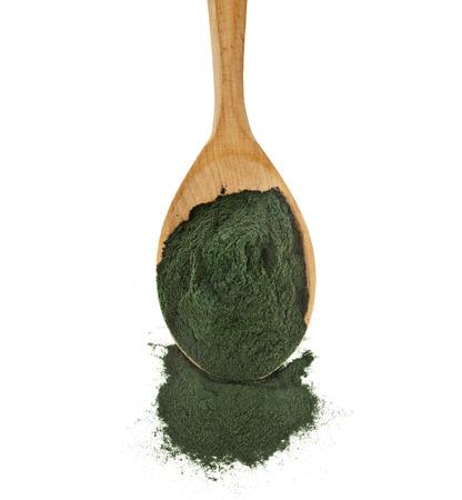 organic spirulina algae powder in wooden spoon isolated on white background
