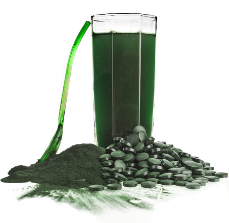 Spirulina algae powder glass drink nutritional supplement close up , isolated on white background
