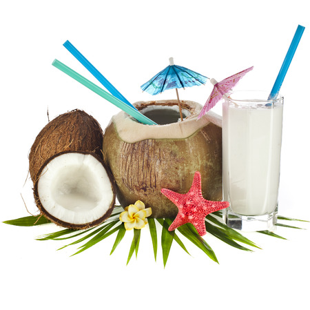 coconut drink: Coconut drink with a straw and palm leaf isolated on white background Stock Photo