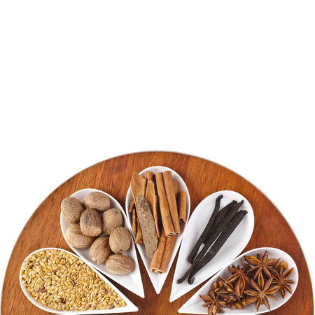 wholegrain mustard: different spice seed in white porcelain dishes surface top view over wooden board background