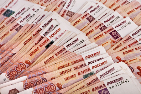 http://us.123rf.com/450wm/madllen/madllen1406/madllen140600454/29425752-heap-of-five-thousand-russian-rubles-banknotes-surface-top-view-background.jpg