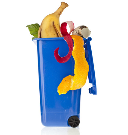 organic waste: Blue Dumpster filled household waste kitchen scraps isolated on white background