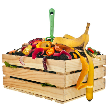 hayfork: kitchen scraps in compost soil pile wooden crate box isolated on white background Stock Photo