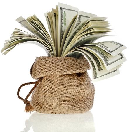sack bag full money banknotes isolated on a white background photo