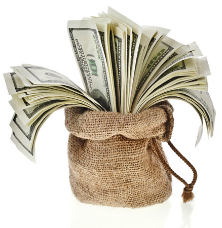 Money banknotes in the sack bag isolated on a white background photo