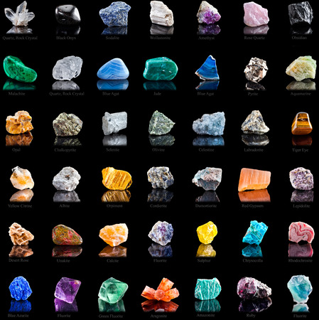 Collection set of semi-precious gemstones stones and minerals with names on black background photo