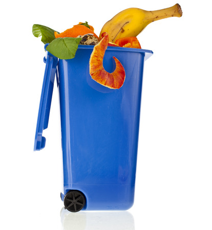 dumpster: Blue Dumpster filled household waste kitchen scraps isolated on white background
