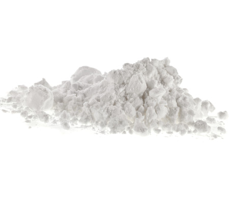 powdered sugar: starch heap pile isolated on white background Stock Photo