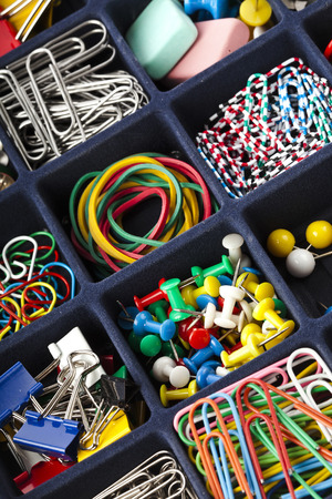 paper clips: stationery collection in black box surface top view