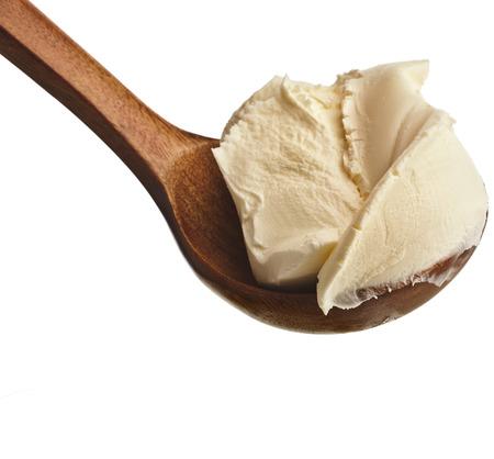 mascarpone: Mascarpone on wooden spoon Isolated on White Background
