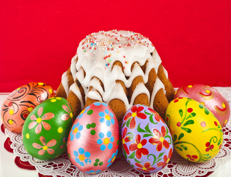 easter bread cake and colored egg on red background photo