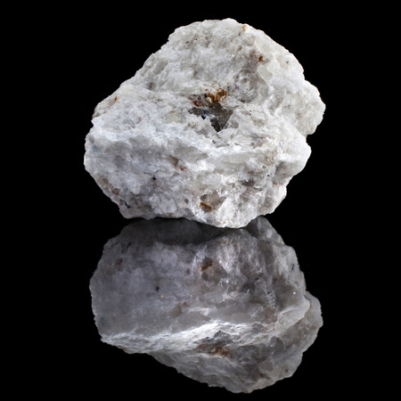 lapidary: Albite mineral rock with reflection on black surface background Stock Photo