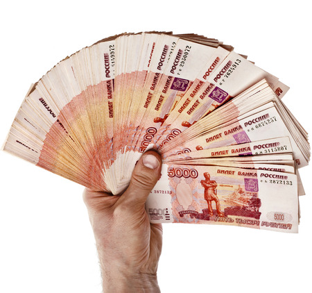 http://us.123rf.com/450wm/madllen/madllen1406/madllen140600832/29514872-fan-of-one-million-banknotes-rubles-of-the-russian-federation-in-man-hand--isolated-on-white-backgro.jpg