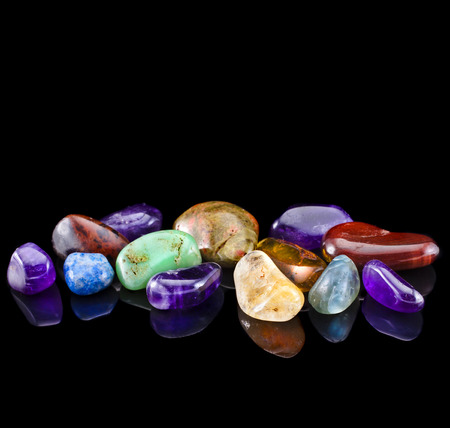semiprecious: Semi-precious stones against black background with copy space for text