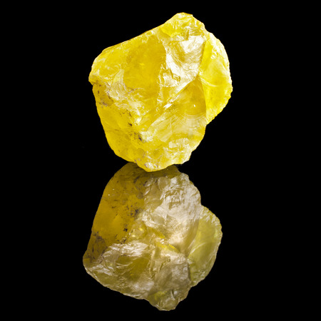 Large Crystal Yellow Sulphur with reflection on black surface background Stock Photo