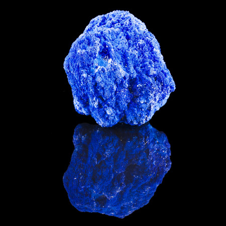 sulfide: Blue Azurite mineral stone, with reflection on black surface background Stock Photo