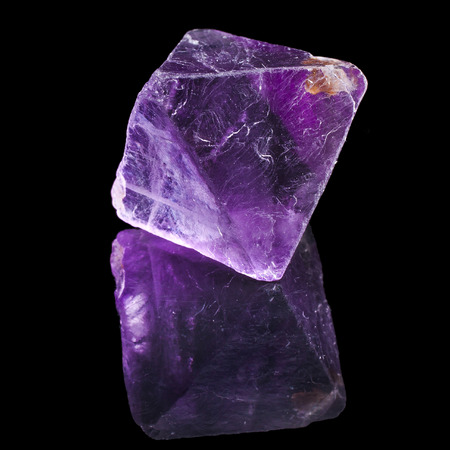 halide: Purple Violet Fluorite with reflection on black surface background
