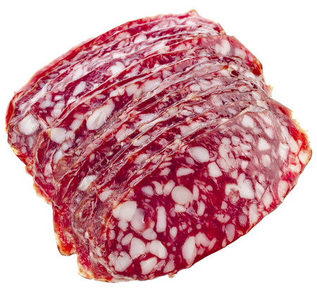 dinne: sliced pieces of sausage salami top view close up isolated on white