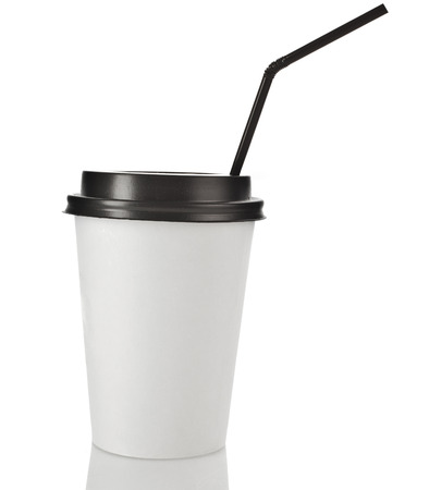 Disposable cup for hot drinks with black top and straw isolated on white background photo