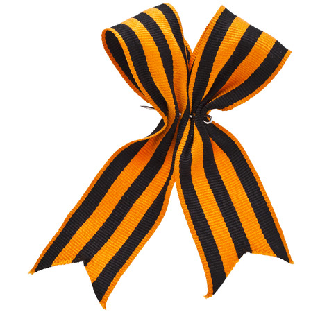 black orange strip ribbon bow surface close up isolated on white background photo