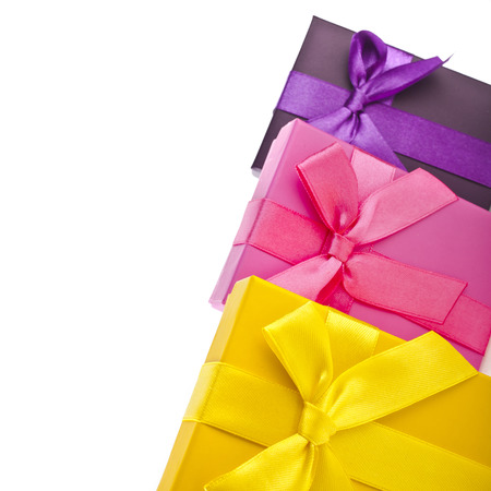 fancy box: many colorful gift boxes wrapped ribbon bows isolated on white background