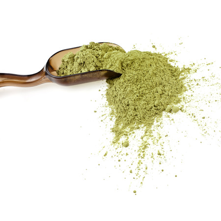 matcha: Powdered Green Tea Matcha in spoon , isolated on white background Stock Photo