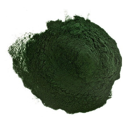 Spirulina powder algae nutritional supplement heap surface close up top view, isolated on white background
