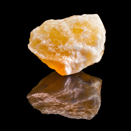aragonite: Calcite crystal with reflection on black surface background Stock Photo