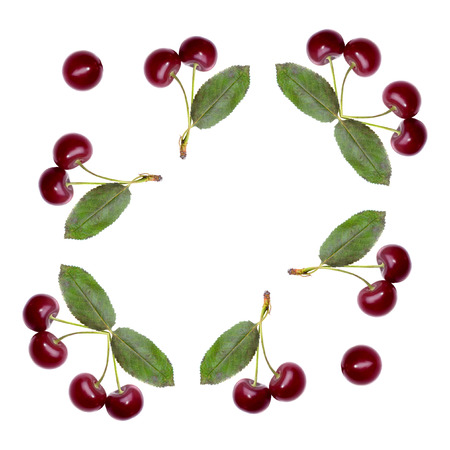 Abstract frame decor of ripe cherry friuts isolated on white background photo