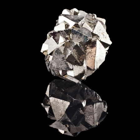 captivating: Pyrite with reflection on black surface background Stock Photo