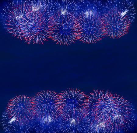 border frame of fireworks of various colors over night sky photo