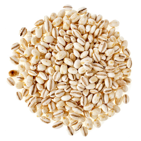 Pearl Barley Heap top view surface close up macro isolated on white Background