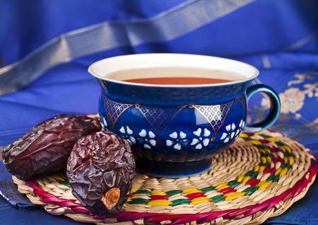 Black coffee with dates - a middle eastern refreshment drink