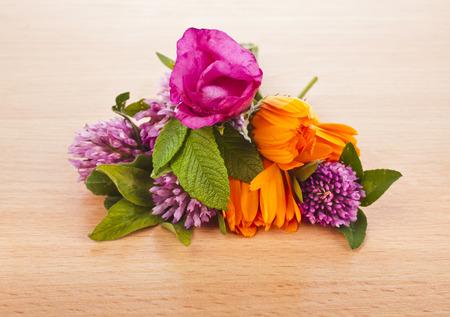 trillium: herbal flower groups on wooden surface background