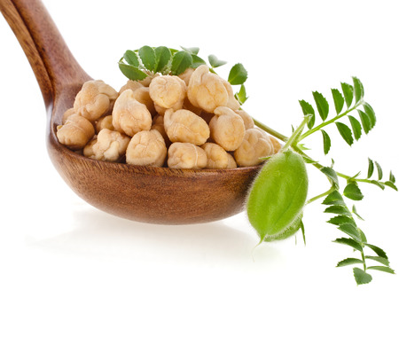 chickpeas seed over wooden spoon isolated on white background photo