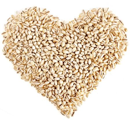 pearl barley: pearl barley shape heart close up surface top view background
