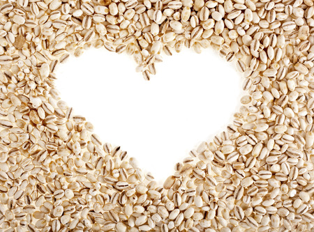 pearl barley frame shape heart close up surface top view background photo