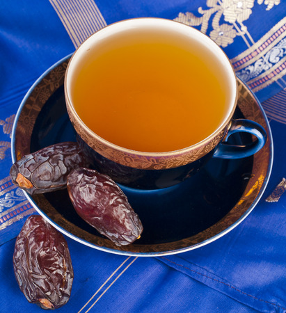 Ramadan eastern refreshment drink with dates on table top view photo