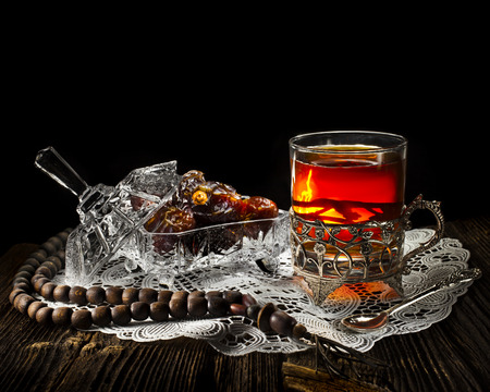 Ramadan festival in wooden table isolated on black background photo