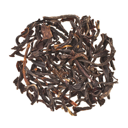 assam: dry black tea leaves Assam India, heap top view surface  isolated on white background Stock Photo