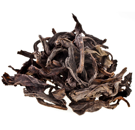 robes: Heap pile of Da Hong Pao Black Tea isolated on white background Stock Photo