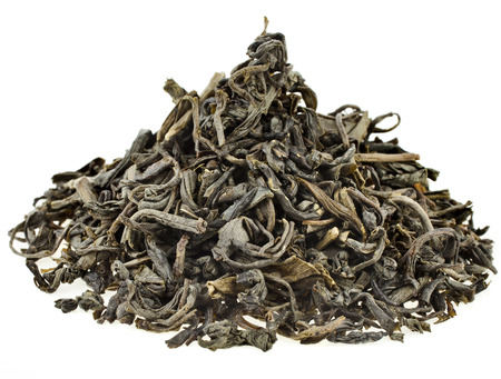 asian produce: Heap pile of dry green tea leaves isolated on white background