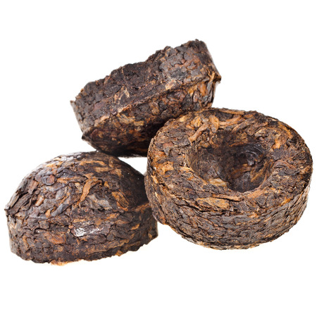 pu: Heap pile of Pressed Black Tea Pu-Erh isolated on white background Stock Photo