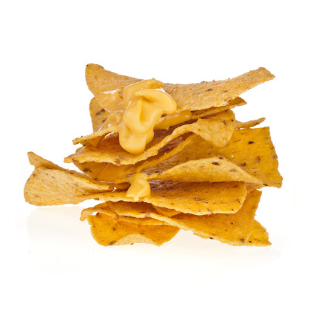 corn chip: Salted chip nacho snack with pepper isolated on white background